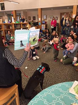 Heidi reading to little ones