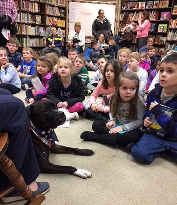 Heidi & Reed reading to kids